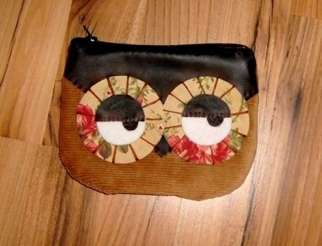 Hoot hoot! .  Sew a fabric animal pouch in under 90 minutes by constructing and sewing with fabric, sewing machine, and zipper. Creation posted by Anna H. Difficulty: Simple. Cost: Cheap.