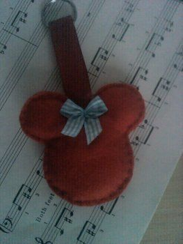 Pretty little keyring .  Sew a fabric character charm in under 60 minutes by needleworking and sewing with felt, ribbon, and embroidery thread. Inspired by mickey & minnie mouse and clothes & accessories. Creation posted by michelle m. Difficulty: Easy. Cost: Absolutley free.