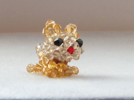 Beaded animals .  Make a beaded animal by beading with bicone beads. Inspired by creatures and giraffe. Creation posted by shelby. Difficulty: 4/5. Cost: 3/5.