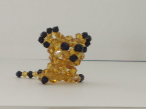 My beaded animals 2 .  Make a beaded animal by beading and beading with bicone beads. Inspired by cats and creatures. Creation posted by shelby. Difficulty: 4/5. Cost: 3/5.