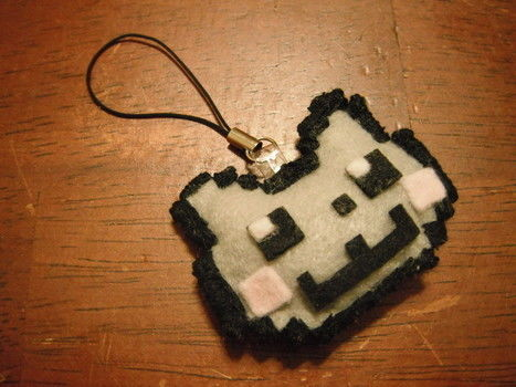 Nyan nyan~ .  Free tutorial with pictures on how to make a fabric animal charm in 5 steps by embroidering and sewing with scissors, thread, and glue. Inspired by anime & manga, creatures, and geeky. How To posted by bunnytan. Difficulty: 3/5. Cost: Absolutley free.