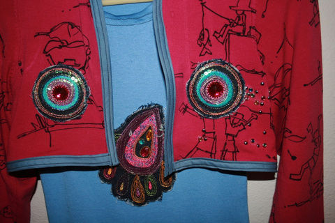 Upcycled girls dress and bolero, just in time for back-to-school .  Free tutorial with pictures on how to recycle a sweater into a dress in under 180 minutes by studding, sewing, and dressmaking with thread, sweater, and applique. Inspired by clothes & accessories. How To posted by DesigntoInspire. Difficulty: 3/5. Cost: Cheap. Steps: 9