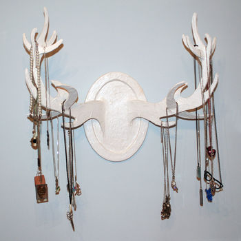Dramatic way to display your jewelry .  Make a taxidermy mount in under 120 minutes by Papier-mâchéing with paint and foam. Inspired by clothes & accessories. Creation posted by Polly A. Difficulty: 3/5. Cost: Cheap.