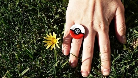 A cute pokéball-inspired ring, perfect for any Pokémon fan! .  Free tutorial with pictures on how to make a button ring in 8 steps by decorating with glue, masking tape, and ring base. Inspired by pokemon, anime & manga, and costumes & cosplay. How To posted by Lauren. Difficulty: Simple. Cost: No cost.