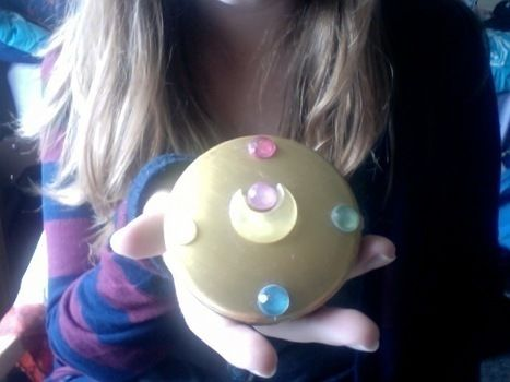 Moon Prism Power! .  Make a recycled brooch in under 120 minutes by spraypainting and decorating with paint, plastic gems, and compact mirror. Inspired by anime & manga, sailor moon, and costumes & cosplay. Creation posted by Mary Kate . Difficulty: Easy. Cost: Absolutley free.