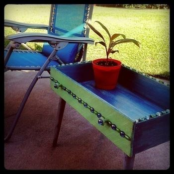 Turn an old drawer into a handy patio & garden table! .  Make a recycled table in under 180 minutes by constructing, decorating, embellishing, and marbling with paint, varnish, and glass. Inspired by vintage & retro. Creation posted by Colleen ChromeSkies. Difficulty: Simple. Cost: Cheap.