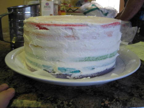 Rainbow cake aint easy .  Bake a rainbow cake in under 150 minutes by baking with cake mix, buttercream icing, and icing gel pen. Inspired by cupcakes and cake. Creation posted by Sasha A. Difficulty: 3/5. Cost: Cheap.