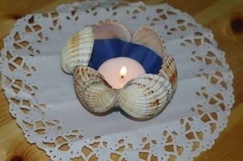 Another way to use your shell's from vacation. .  Make a shell candle in under 10 minutes by constructing with hot glue gun, cardboard, and shell. Creation posted by Marianne K. Difficulty: Easy. Cost: No cost.