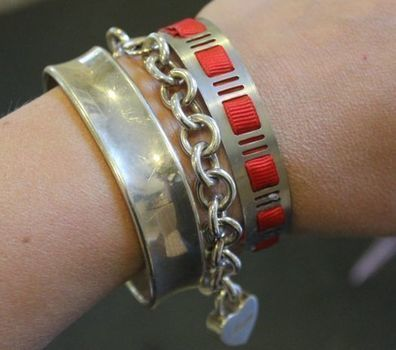 Turn a hose clamp in to a bracelet. .  Free tutorial with pictures on how to make a metal cuff in under 2 minutes by jewelrymaking with ribbon, glue, and hose clamp. How To posted by Stephanie @ Henry Happened. Difficulty: Simple. Cost: Cheap. Steps: 4