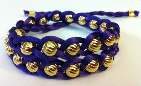 DIY $220 BRACELET FOR $5 .  Free tutorial with pictures on how to braid a braided bead bracelet in under 30 minutes by jewelrymaking with beads and ribbon. How To posted by Stephanie @ Henry Happened. Difficulty: Simple. Cost: Cheap. Steps: 5