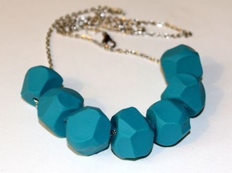 Mould a clay necklace. .  Free tutorial with pictures on how to sculpt a clay bead necklace in under 20 minutes by jewelrymaking and molding with clay, toothpick, and knife. How To posted by Stephanie @ Henry Happened. Difficulty: Simple. Cost: Cheap. Steps: 6