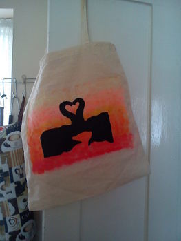 Transform a plain tote .  Paint a painted tote in under 180 minutes by stencilling and decorating with fabric, buttons, and paint. Inspired by elephants and hearts. Creation posted by Lisa C. Difficulty: 3/5. Cost: Cheap.