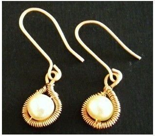 Classy coiled wire wrapped earrings .  Make a pair of wire earrings by jewelrymaking with round beads and copper. Inspired by clothes & accessories. Creation posted by Jane. Difficulty: Simple. Cost: Cheap.