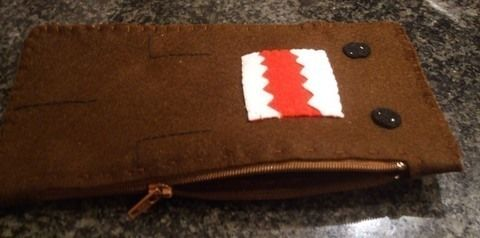 A monstrous pouch! .  Free tutorial with pictures on how to sew a fabric character pouch in under 90 minutes by embroidering and sewing with scissors, felt, and thread. Inspired by domo kun and monsters. How To posted by Lima. Difficulty: Simple. Cost: No cost. Steps: 11