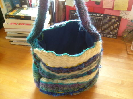 A shoulder bag made on a peg loom in varying shades of blue  .  Make a knit or crochet tote by sewing and weaving with scissors, yarn, and lining fabric. Inspired by hippy and clothes & accessories. Creation posted by surfergrl. Difficulty: Simple. Cost: 3/5.