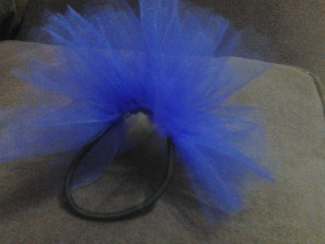 """Jazz up a hairstyle with a """"tully"""" look! .  Sew a tulle headband in under 15 minutes by not sewing with scissors, tulle, and hair elastic. Inspired by clothes & accessories. Creation posted by Michelle J. Difficulty: Easy. Cost: Absolutley free."""