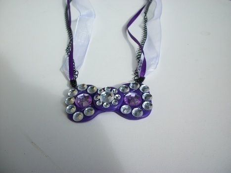 A little *BLING* to your lolita/goth accessories  .  Mold a clay necklace in under 60 minutes by constructing, embellishing, jewelrymaking, molding, and  with polymer clay, sequins, and necklace chain. Inspired by lolita, gothic, and kawaii. Creation posted by Sally M. Difficulty: Simple. Cost: Cheap.