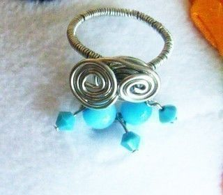 Beaded and wired dangle spiral ring .  Make a wire ring by jewelrymaking with beads, wire, and pins. Inspired by clothes & accessories. Creation posted by Jane. Difficulty: Easy. Cost: Cheap.