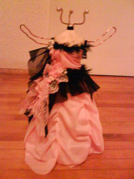 Pretty,and decoreted in ones own style .  Make a jewelry mannequin by beading, decorating, dyeing, needleworking, wireworking, and woodworking with wood, wire, and decorations. Inspired by clothes & accessories. Creation posted by Alexandra F. Difficulty: 4/5. Cost: Cheap.