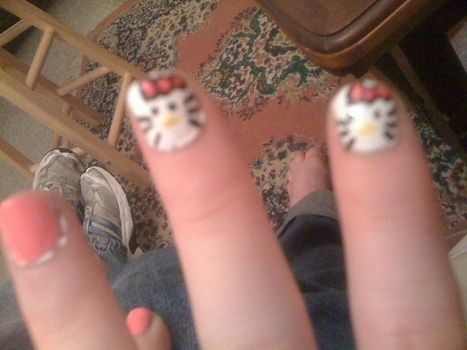 Very cute hallo kitty style nails .  Paint an animal nail in under 20 minutes by nail painting with nail polish, nail polish, and nail polish. Inspired by cats. Creation posted by TamrynRoxanne. Difficulty: Easy. Cost: No cost.