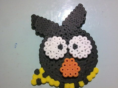 Double-faced keychain  .  Make a beaded character in under 60 minutes using perler beads, perler beads, and perler beads. Inspired by anime & manga and clothes & accessories. Creation posted by Alex A. Difficulty: 3/5. Cost: Cheap.