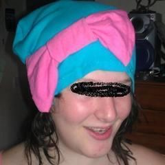 Turquoise Beanie Hat With Pink Bow.