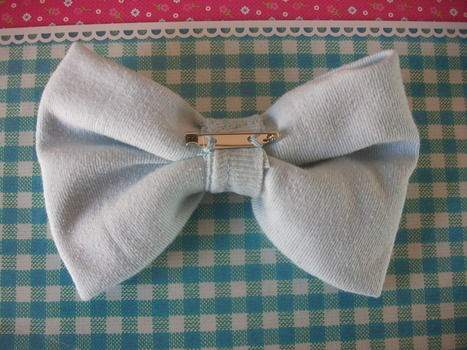Easy beautiful to make bow broche! .  Make a fabric brooch by jewelrymaking, sewing, and sewing with fabric, fabric scissors, and bar pin. Inspired by bows and bows. Creation posted by petitefoxy. Difficulty: Easy. Cost: No cost.