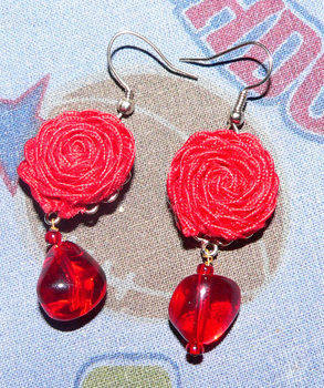 Rick rack  earrings  .  Make a set of ribbon earrings in under 30 minutes by jewelrymaking with glass beads, earring loops , and rick rack. Creation posted by Fariha. Difficulty: Easy. Cost: No cost.