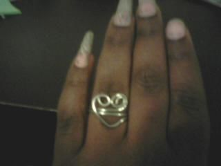 Fun and cool heart shape ring .  Make a ring in under 20 minutes by metalworking and wireworking with wire. Inspired by kawaii, hearts, and hearts. Creation posted by Kenisha F. Difficulty: 4/5. Cost: No cost.