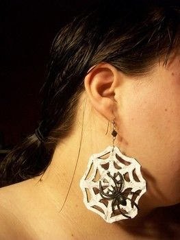 Easy, cheap earrings for halloween loving all year 'round! .  Free tutorial with pictures on how to make a pair of fabric earrings in under 30 minutes by beading and decorating with scissors, acrylic paint, and hot glue gun. Inspired by creatures, gothic, and spiders. How To posted by Zombicology. Difficulty: Simple. Cost: Cheap. Steps: 1