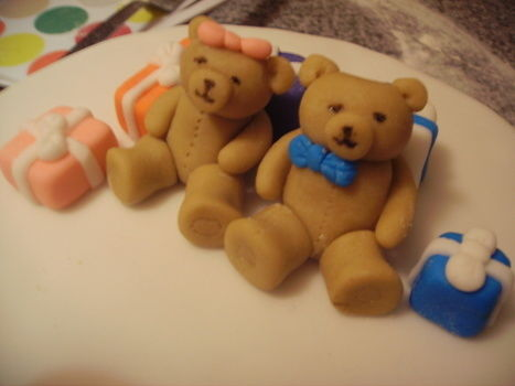 A cake topper for my Aunt and Uncles birthday .  Decorate an animal cake in under 120 minutes by cooking, baking, decorating food, molding, and cake decorating with sugar and food. Inspired by bears, bears, and cake. Creation posted by Catherine G. Difficulty: 3/5. Cost: Cheap.