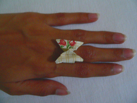 Butterfly ring .  Free tutorial with pictures on how to make a paper ring in under 10 minutes by paper folding and jewelrymaking with origami paper. How To posted by Fariha. Difficulty: Easy. Cost: No cost. Steps: 1