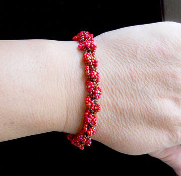 Blends almost seamlessly into the rope when closed! .  Free tutorial with pictures on how to bead a woven bead bracelet in under 20 minutes by beading with seed beads. Inspired by clothes & accessories. How To posted by Stacey D. Difficulty: Easy. Cost: Cheap. Steps: 1