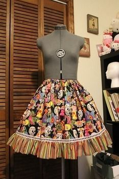 Happy Little Skeletons! .  Make a bustle skirt in under 180 minutes by sewing with fabric, fabric, and thread. Inspired by skulls & skeletons, clothes & accessories, and day of the dead. Creation posted by Jessica. Difficulty: Easy. Cost: 3/5.