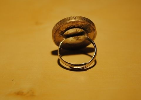 Easy to make ring with old coins glued onto ring blank .  Make a coin ring in under 10 minutes by jewelrymaking with glue, ring, and coin. Inspired by vintage & retro and clothes & accessories. Creation posted by Roula Rouge. Difficulty: Easy. Cost: Cheap.