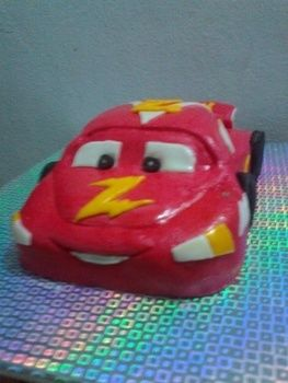 Lightning Mcqueen cake .  Free tutorial with pictures on how to decorate a car cake in under 180 minutes by baking and decorating food with cake mix, buttercream icing, and oreos. Inspired by cars and cupcakes. Recipe posted by ihsana z. Difficulty: Easy. Cost: Cheap. Steps: 8