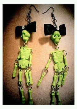 Skeletons! .  Make a pair of toy earrings in under 10 minutes by jewelrymaking with bow, fish, and skeleton. Inspired by skulls & skeletons. Creation posted by Dearly and Departed Creations. Difficulty: Easy. Cost: Absolutley free.
