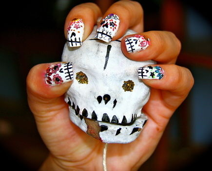 Day of the dead .  Free tutorial with pictures on how to paint a character nail in under 30 minutes by creating, nail painting, decorating, and nail painting with nail polish and gems. Inspired by skulls & skeletons and day of the dead. How To posted by ocean o. Difficulty: Easy. Cost: Absolutley free. Steps: 1