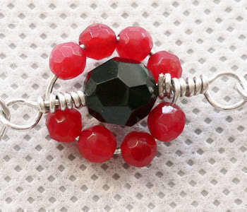 Wire wrapping, making loops,. linking .  Free tutorial with pictures on how to make a wire bracelet in 8 steps by jewelrymaking with wire, bead, and round beads. Inspired by clothes & accessories. How To posted by Jane. Difficulty: Easy. Cost: No cost.