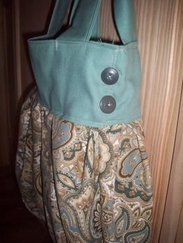 Based on Anthropologie Inspired Bag by Modesty Fashions  .  Sew a bow bag in under 180 minutes by sewing with fabric, sewing machine, and buttons. Inspired by clothes & accessories and anthropologie. Creation posted by =^.^= I'macat . Difficulty: 3/5. Cost: Cheap.