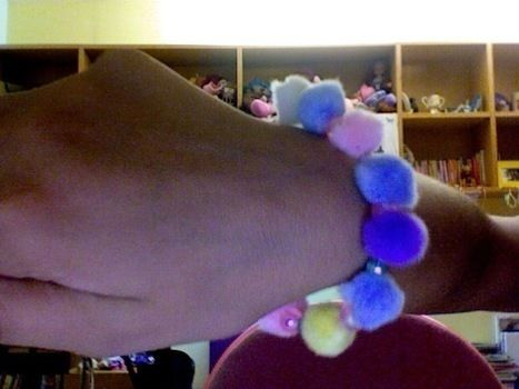 Poofy bracelet, perfect for decora or fairy kei .  Make a pom pom bracelet in under 60 minutes by beading and needleworking with pom pom, glass pearl beads, and bead. Creation posted by Annika G. Difficulty: Easy. Cost: No cost.
