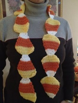 Halloween fashion Inspired by Candy Corns .  Free tutorial with pictures on how to make a novelty scarf in 4 steps by crocheting with yarn, yarn, and yarn. Inspired by halloween, clothes & accessories, and candy corn. How To posted by Kari D. Difficulty: Easy. Cost: Cheap.