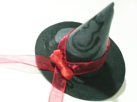 Check out my video tutorial ;) http://www.youtube.com/watch?v=Q8ShkW1nHO0 .  Free tutorial with pictures on how to make a novelty hat in under 15 minutes by creating, drawing, hairstyling, decorating, embellishing, etching, jewelrymaking, papercrafting, cardmaking, collage, paper folding, Papier-mâchéing, scrapbooking, stencilling, and dressmaking with paper and acrylic paint. Inspired by halloween, anime & manga, and gothic. How To posted by Musta-Kissa. Difficulty: Simple. Cost: Absolutley free. Steps: 1