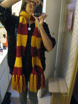 From the Harry Potter Series! Of course [: .  Free tutorial with pictures on how to knit or crochet a stripy scarf in 15 steps by crocheting with scissors, yarn, and yarn. Inspired by harry potter, costumes & cosplay, and clothes & accessories. How To posted by indirectkiss. Difficulty: Simple. Cost: Cheap.