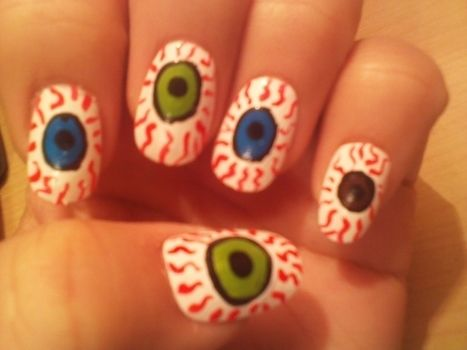 An easy way to disguise your nails for halloween or when ever you feel like beign unique!! .  Free tutorial with pictures on how to paint a themed nail manicure in under 15 minutes by nail painting and nail painting with nail polish, nail polish, and nail polish. Inspired by eyeballs and eyeballs. How To posted by Nail Art and other DIY. Difficulty: Easy. Cost: Cheap. Steps: 7