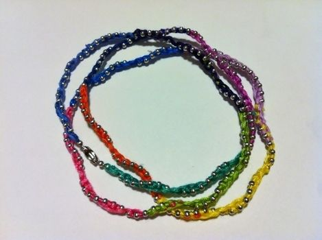 A Great Update to Friendship Bracelets .  Free tutorial with pictures on how to make a chain bracelet in under 60 minutes by jewelrymaking with scissors, needle, and embroidery thread. How To posted by Princess Pam-attitude . Difficulty: Easy. Cost: Absolutley free. Steps: 4