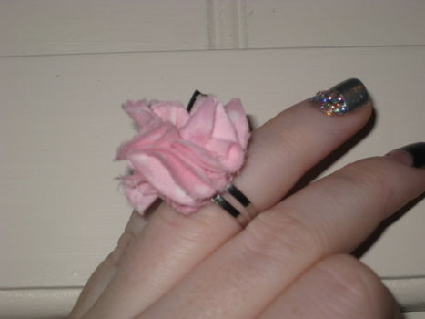 Very simple fabric ring .  Free tutorial with pictures on how to make a fabric ring in under 10 minutes by sewing with fabric, felt, and hot glue gun. Inspired by flowers. How To posted by TamrynRoxanne. Difficulty: Easy. Cost: No cost. Steps: 7