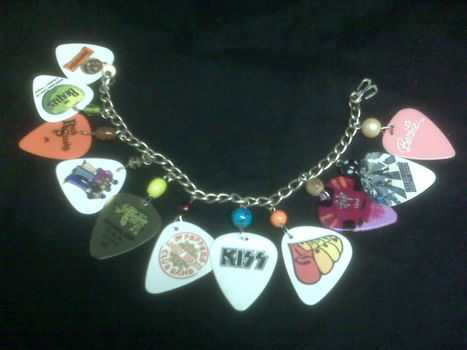 A fairly simple project that was fun to make and looks really rockin'! .  Recycle a guitar pick bracelet in under 120 minutes by beading and jewelrymaking with beads, jump rings, and chain. Inspired by the beatles, clothes & accessories, and guitar. Creation posted by Elyse W. Difficulty: Simple. Cost: Cheap.