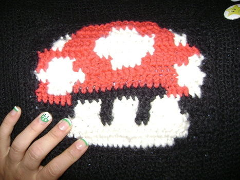 Mushroom nails and a crocheted mushroom bag .  Paint a character nail in under 30 minutes by creating, nail painting, and nail painting with nail polish. Inspired by super mario, super mario, and kawaii. Creation posted by Kally. Difficulty: Easy. Cost: Absolutley free.