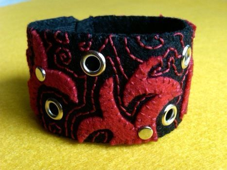 Unisex bracelet / cuff .  Make a fabric cuff by creating, embellishing, studding, needleworking, and sewing with felt, velcro, and creativity. Inspired by clothes & accessories. Creation posted by Michele G. Difficulty: Easy. Cost: 3/5.